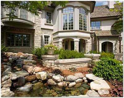Преимущества внешней отделки фасада дома искусственным камнем
